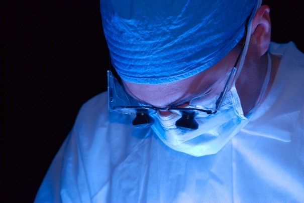 Surgeon with magnifying lenses